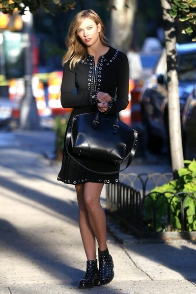 Karlie Kloss strolled the streets of New York in a grommet embellished dress by Michael Kors that featured silver hardware and an above-the-knee cut.