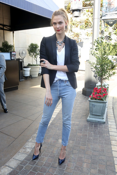 Karlie Kloss was casual-chic in a black blazer layered over a white V-neck tee while out and about.