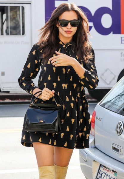 Shayk covered her pregnant tummy in a printed mini dress that she paired with over-the-knee boots, a black handbag, and dark sunnies while out in Los Angeles.