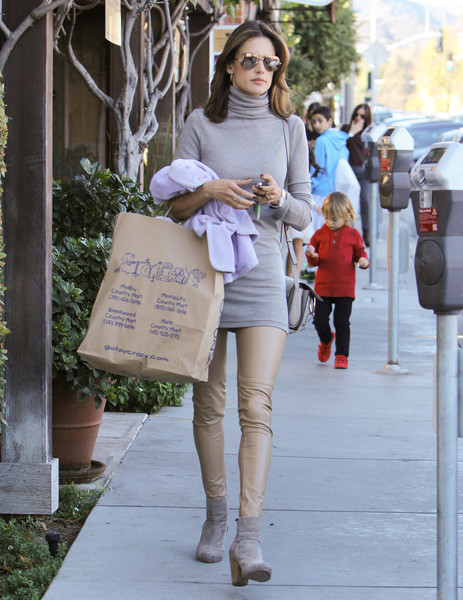 Alessandra Ambrosio bundled up in a gray turtleneck for a day of shopping.