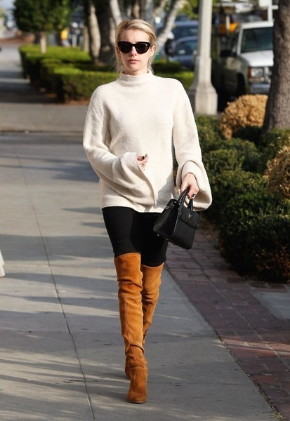 Emma Roberts showed off her chic cold-weather style with this cream-colored bell-sleeve turtleneck by Forever 21 while visiting the salon.