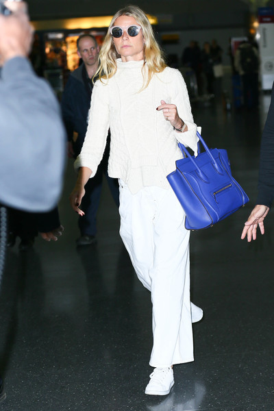 Gwyneth Paltrow was spotted at JFK wearing a white cable-knit turtleneck.