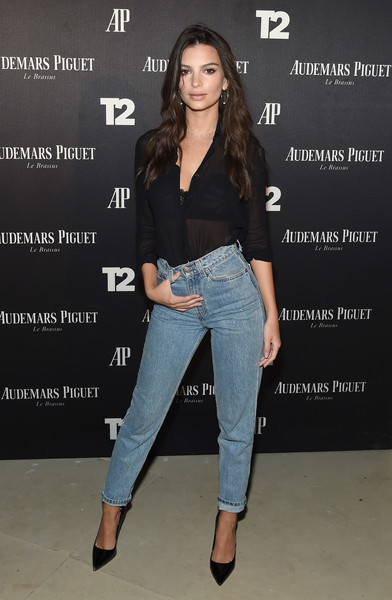 Emily Ratajkowski looked subtly seductive in a sheer black button-down at the Miami Beach kickoff party.