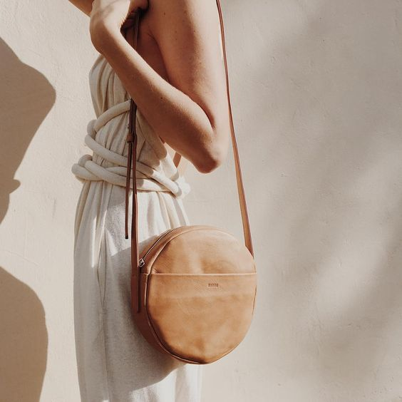 Simple geometric bag made of naturally milled, butter-soft leather.