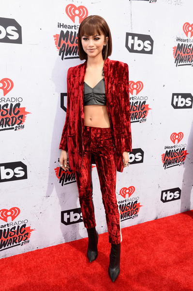 Zendaya Coleman was glam-rock in a red Haider Ackermann velvet pantsuit teamed with a black leather crop-top at the iHeartRadio Music Awards.