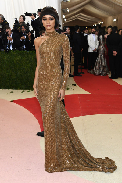 Zendaya Coleman was simply stunning in a bronze chainmail one-sleeve gown by Michael Kors at the Met Gala.