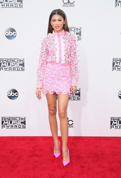 Zendaya Coleman was sweetness overload at the American Music Awards in a pink Emanuel Ungaro flower-appliqued lace top with white ruffle trim.