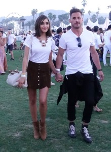 Olivia Culpo wearing a white tee and miniskirt at the festival.