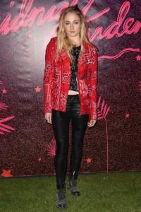 Sophie Turner wearing a bandana printed moto jacket