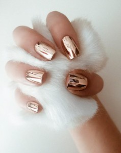 The future is now, and we've already fallen hard for high-shine metallic nail finishes. Go for rose gold if you're feeling adventurous.