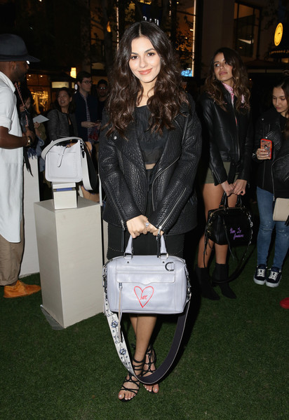 Victoria Justice accessorized with a gray leather bowler bag, also by Rebecca Minkoff.
