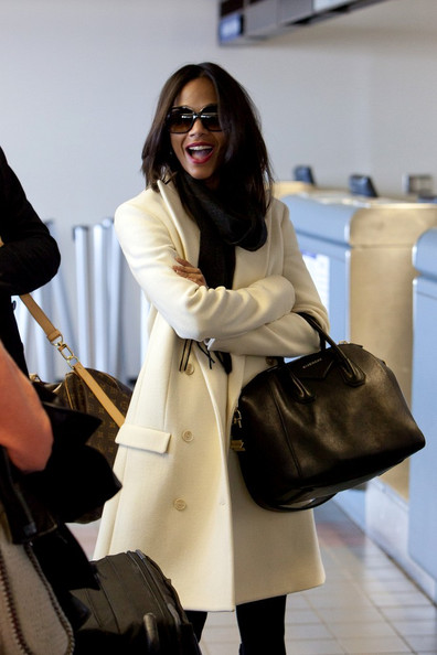 Zoe Saldana traveled in style carrying a black leather Givenchy bowler bag.
