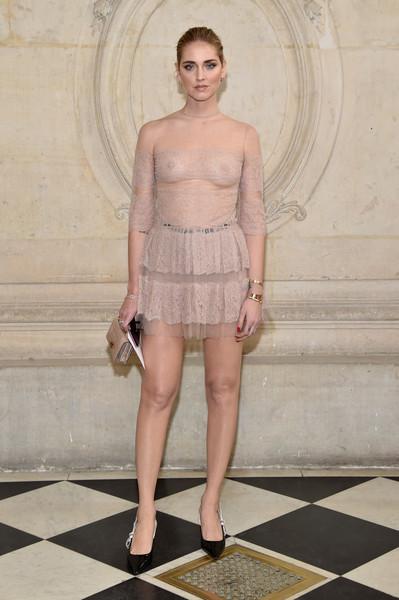 Chiara Ferragni dared to bare in a sheer nude mini dress by Dior during the label's fashion show.