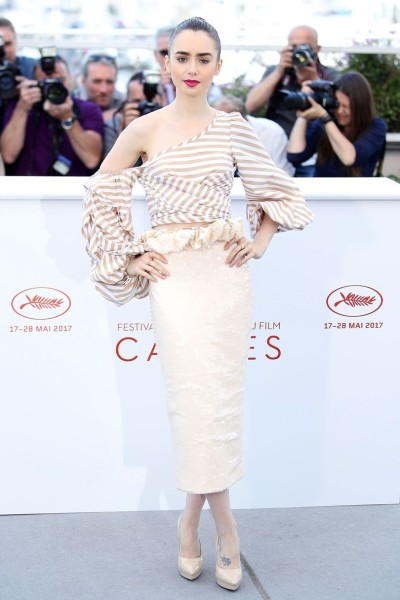 Lily Collins was a true class act at the Okja premiere, the star wore a sequin midi skirt and a shoulder-baring top from Johanna Ortiz' Spring 2017 collection.