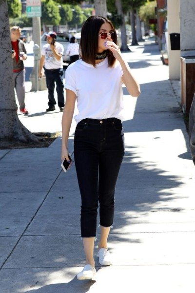 Selena Gomez looks cute and relaxed in a white tee and black ankle pants as she heads to lunch with friends at Gyu-Kaku Japanese BBQ