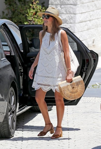 Jessica Alba oozed summertime charm in a scalloped white shift dress by Lovers + Friends while out and about in LA.