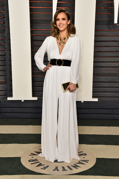 Jessica Alba was all about easy sophistication in a loose, long-sleeve white gown by Roberto Cavalli at the Vanity Fair Oscar party.