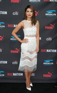 Priyanka Chopra hovered between demure and sultry in a sheer, mixed-pattern LWD by Self Portrait during the Roc Nation pre-Grammy brunch.