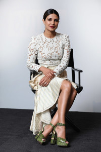 Priyanka Chopra kept it classic up top in a fitted white lace blouse by Zimmermann at the Build LDN event.