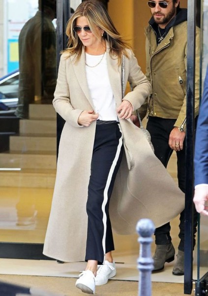 See the chic way Jennifer Aniston styled a T-shirt, track pants, and sneakers in Paris.
