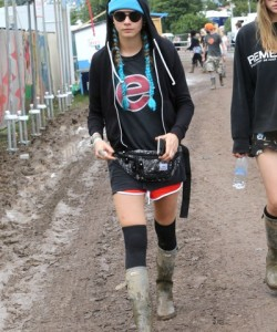 Cara Delevingne takes a more practical approach to the fanny pack, wearing one while attending Day 2 of the Glastonbury Music Festival in 2016.
