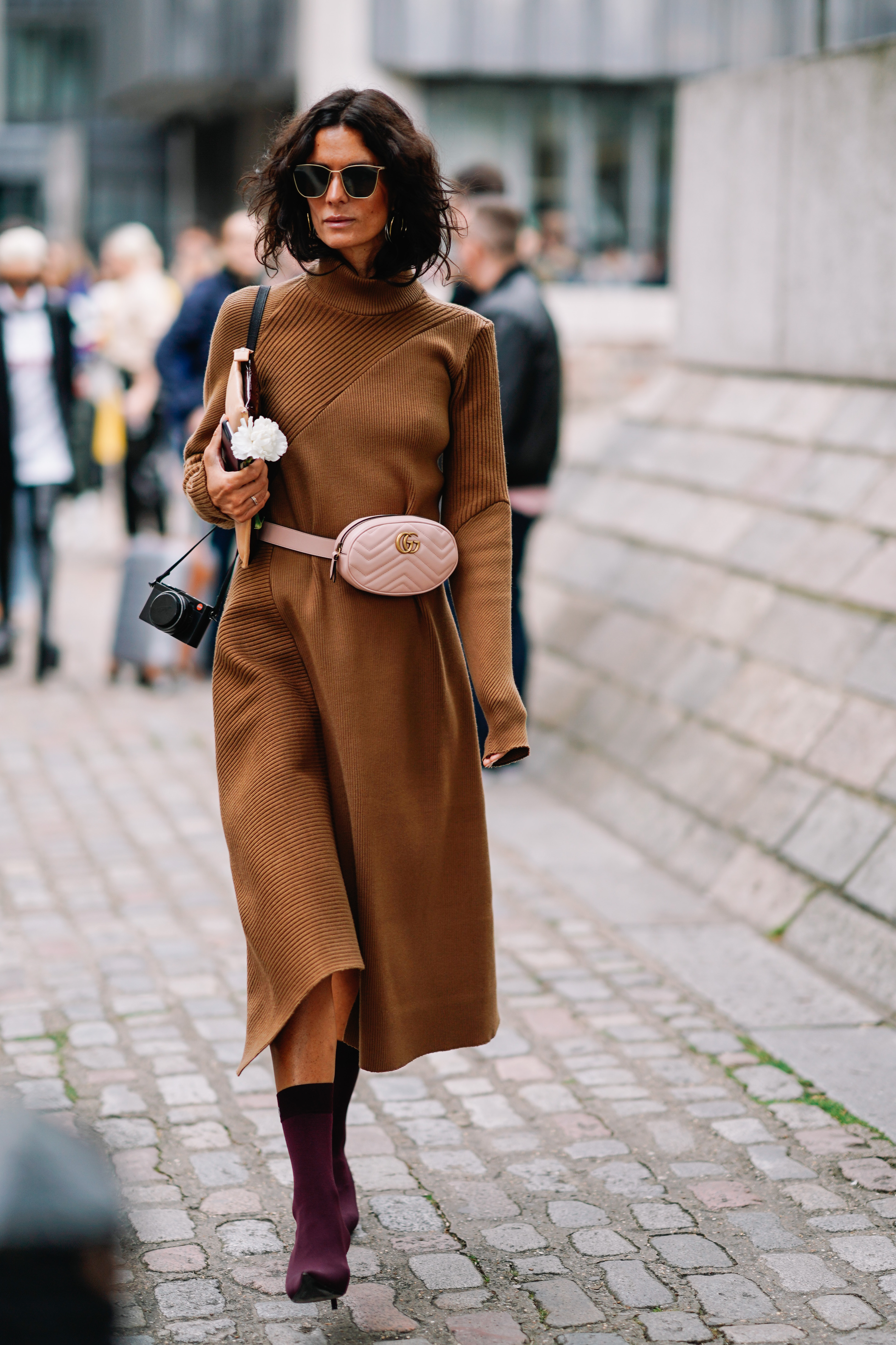LONDON, ENGLAND - SEPTEMBER 17: Hedvig Opshaug wears a brown dress and a Gucci bag, outside Preen by Thornton Bregazzi, during London Fashion Week September 2017 on September 17, 2017 in London, England. (Photo by Edward Berthelot/Getty Images)