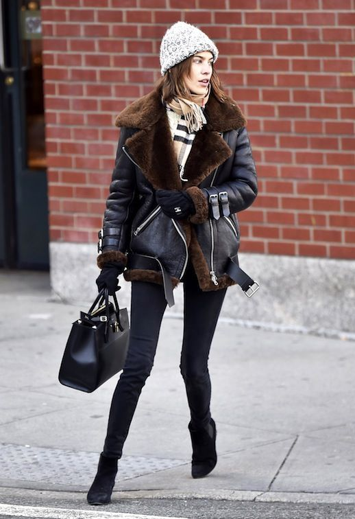 Alexa Chung looks oh-so cozy and chic bundled up in her Acne Studios shearling jacket.