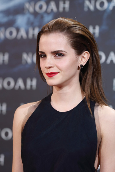 Emma Watson was all about high shine with her brushed back 'do.