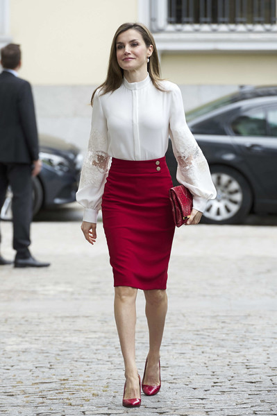 Queen Letizia of Spain added a dazzling pop of color with a raspberry pencil skirt by Hugo Boss.