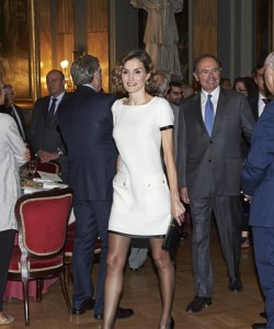 Queen Letizia of Spain chose a white mini dress with black satin trim for the Luis Carandell Journalism Award.