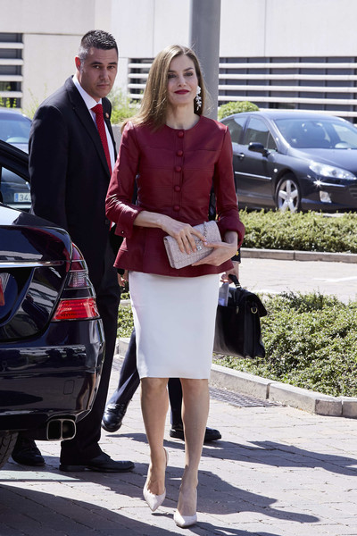 Queen Letizia of Spain looked sharp in a raspberry Carolina Herrera leather jacket paired with a white pencil skirt at the 40th anniversary of Reina Sofia Alzheimer Foundation.