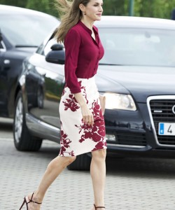 Queen Letizia of Spain looked simply chic in a burgundy button-down by Felipe Varela during the 25th anniversary of the National Center of Food Safety and Technology.
