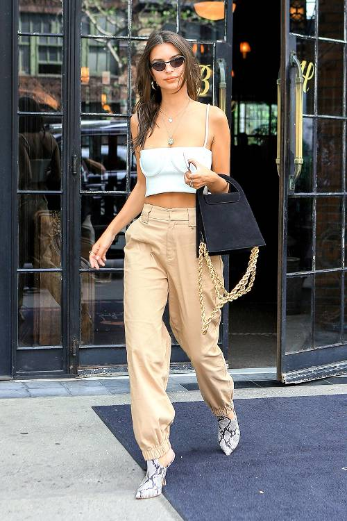 Emily Ratajkowski turned heads on the streets of New York City in a white spaghetti-strap crop-top by Orseund Iris.