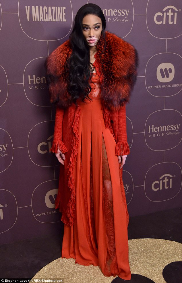 Winnie Harlow steals the show in vampy oversized fur collared jacket at pre-Grammys party.
