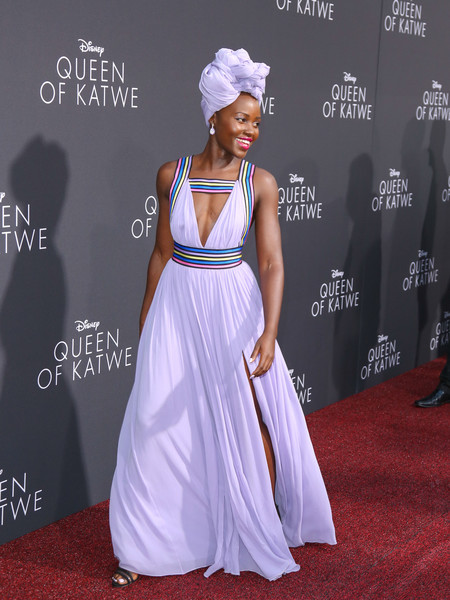 Lupita Nyong'o looked exuberant in a lavender Elie Saab gown with a front cutout, a high side slit, and multicolored striped accents during the premiere of 'Queen of Katwe.'