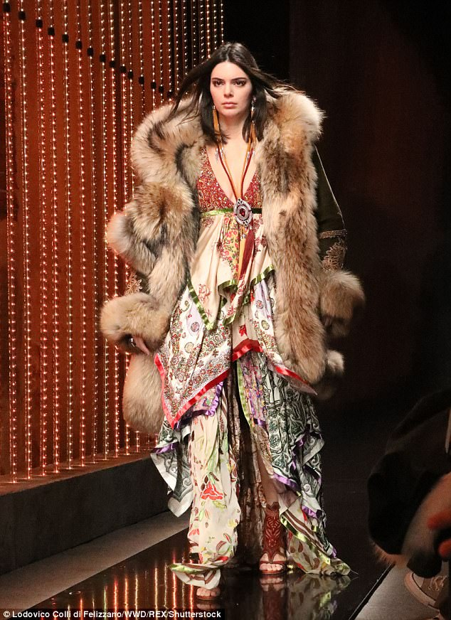Kendall Jenner in stunning Dsquared fur coat . The model showed the men how it was done on the runway at Milan Fashion Week Men's 2018.