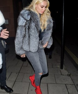 Petra Ecclestone went out for dinner in Mayfair as she put on a glamorous display in a chic grey silverfox fur coat.