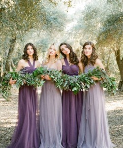 purple one shoulder dresses and grey lavender bridesmaids' gowns