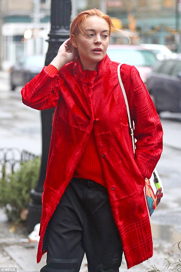 Red Swakara long fur coat wore by Lindsay Lohan in New York.