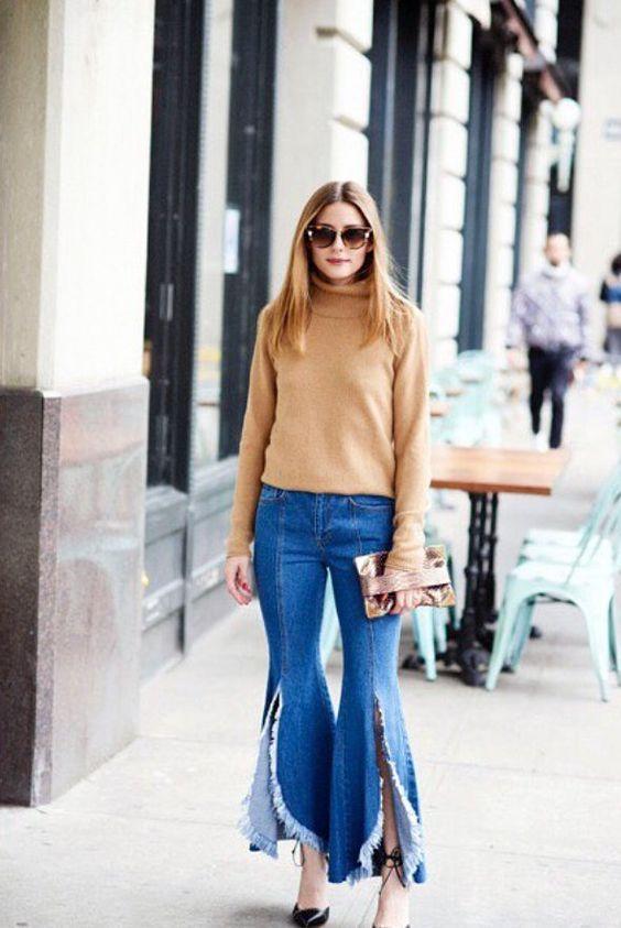 Olivia Palermo wearing split fringed flare jeans