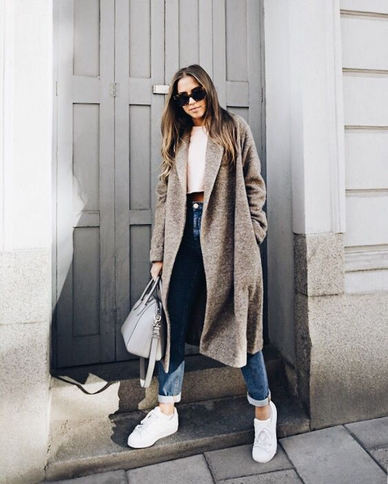 Pair a long coat with cufffed jeans and simple sneakers for an easy outfit this winte