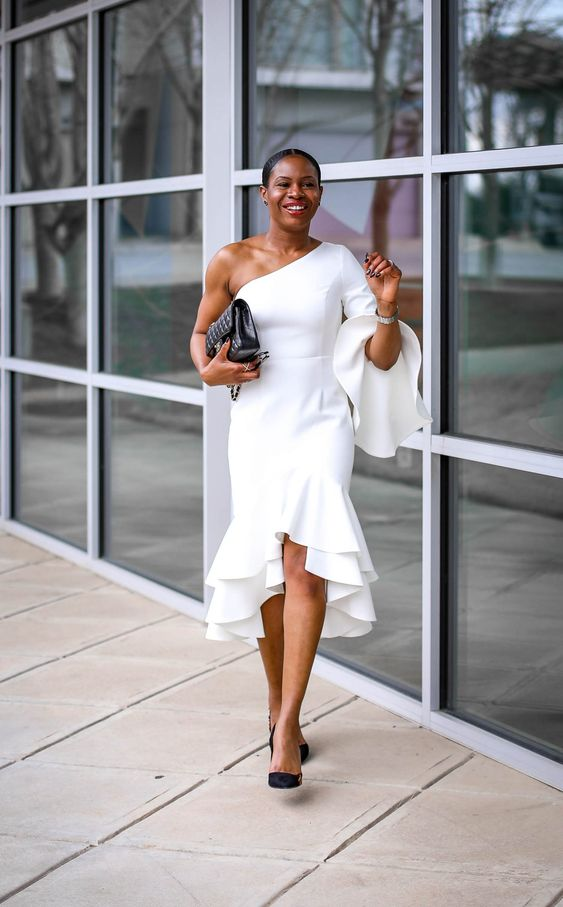 Formal Outfit with A beautiful one sleeve white ruffle dress in stark white.