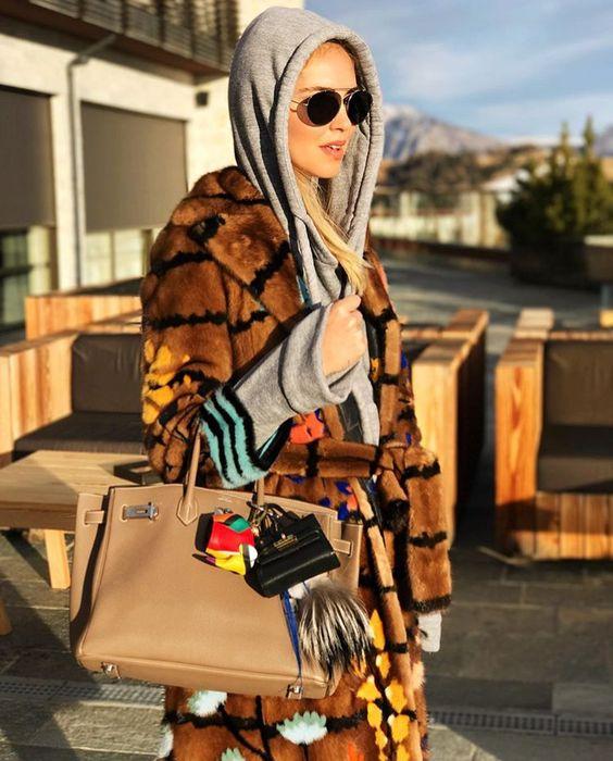Chiara Ferragni in hooded sweater , Fendi coat, Hermes birkin and Karlito keychain !