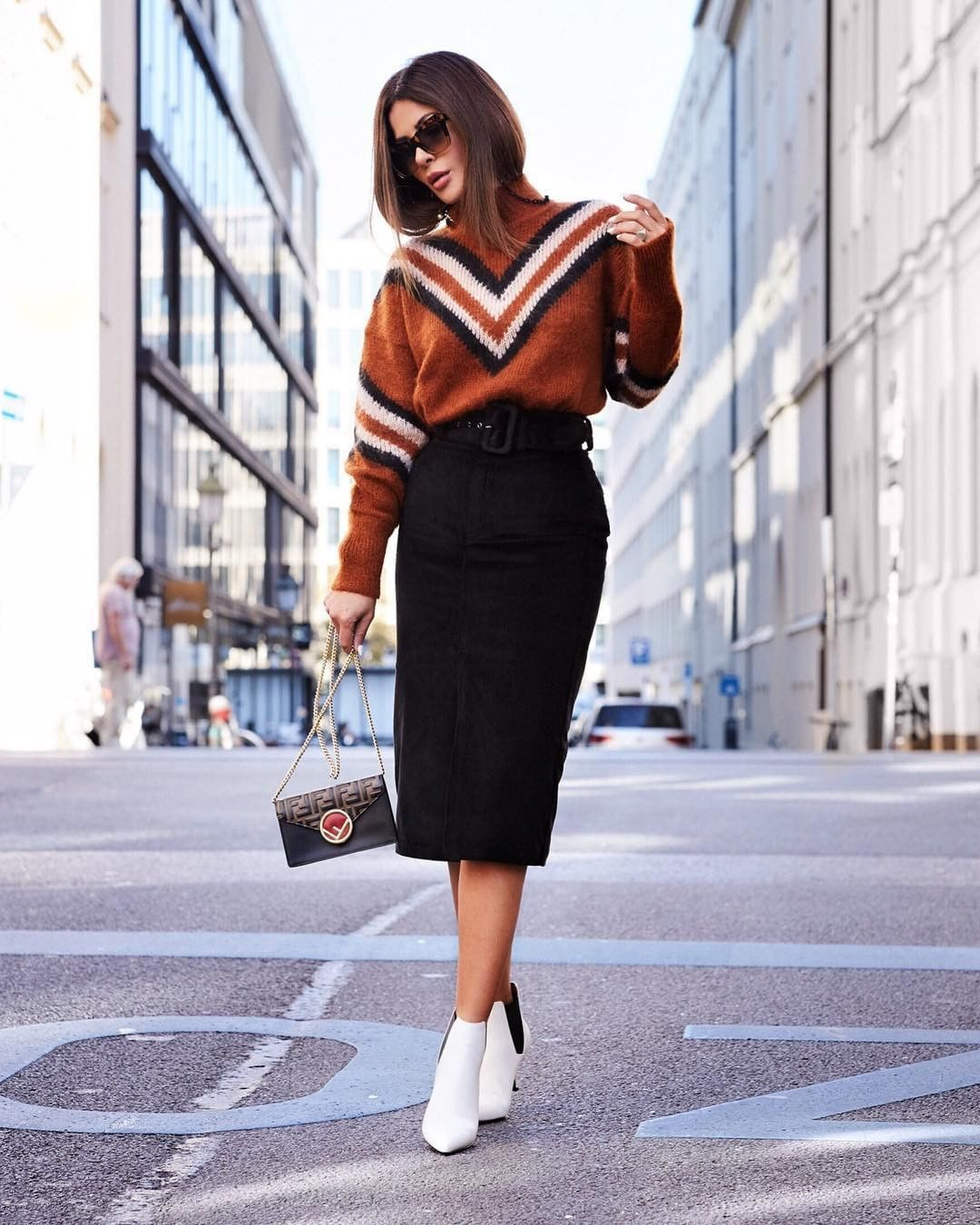 Chic up your collegiate classics a la @shortstoriesandskirts' pencil skirt and white booties