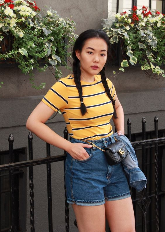 Yellow Striped T-shirt with High-waisted Denim Shorts.