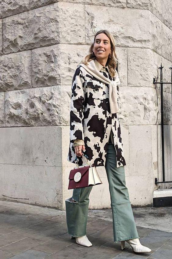 Hannah Lewis wearing a cow print coat